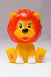 玩具狮子坐 免版税图库摄影