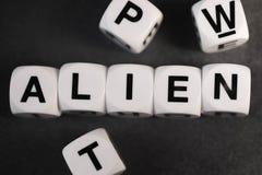 玩具立方体的词外籍人 免版税库存照片