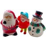 玩具红色圣诞老人和在白色背景的一个雪人 免版税库存图片