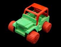 玩具绿色和红色吉普 库存图片