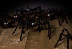 玩具蜘蛛攻击 免版税图库摄影