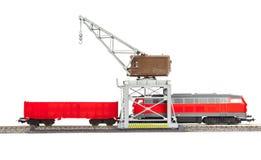 玩具铁路起重机疯子和无盖货车 库存图片