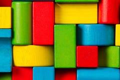玩具阻拦背景,修造砖的孩子 图库摄影