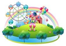 玩杂耍在狂欢节前面的小丑 免版税库存照片