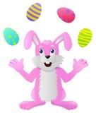 玩杂耍复活节彩蛋的兔子 向量例证
