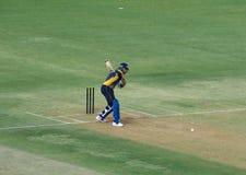 玩板球者击中Sixer的Yuvraj Singh 免版税库存照片