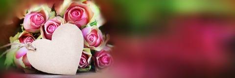 玫瑰花束与招呼的card_001的 库存照片