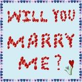 玫瑰花瓣结婚提议在蓝色背景的 免版税图库摄影