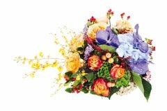 玫瑰,百合,虹膜的植物布置 免版税库存照片