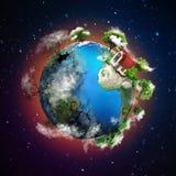环境概念 地球的球形与一张光明面和暗边的 一边是绿色的与房子,另一边是emp 免版税库存照片