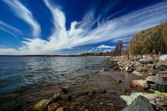 环境美化与象天鹅的云彩在天空 图库摄影