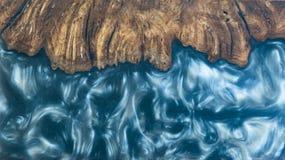 环氧树脂铸件节木红色熔岩抽象背景,纹理Afzelia异乎寻常木 图库摄影