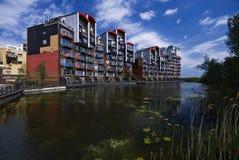 现代发展的湖边 库存图片