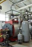现代新的气体加热在锅炉室上铜工作 免版税库存图片