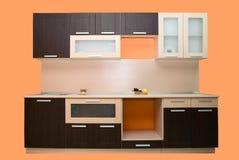现代橙色厨房 免版税库存图片