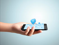 现代移动电话在手中 库存照片