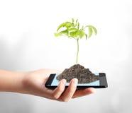 现代移动电话在手中 免版税库存图片