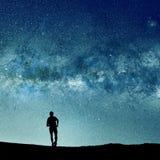 现出轮廓的人和抽象宇宙光 库存图片