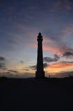 现出轮廓的灯塔在Noord阿鲁巴在黎明 免版税库存照片