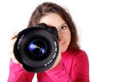 现在她将射击与照相机 库存照片