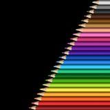 现实五颜六色的铅笔倾斜的线在黑背景的 免版税库存照片