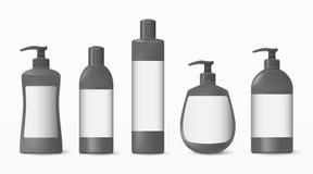 现实化妆塑料瓶的汇集有一个标签的在白色背景 化妆品牌样式 免版税库存图片