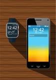 现实智能手机和一块巧妙的手表 库存图片