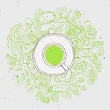 现实杯子与圈子的绿茶乱画 库存照片