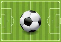 现实橄榄球-在织地不很细领域的足球 图库摄影