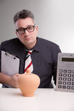 现实的bookkeper和moneybox 免版税库存照片