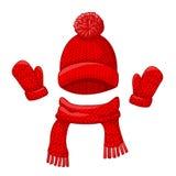 现实红色帽子与一个大型机关炮、围巾和手套集合被编织的季节性冬天 库存照片