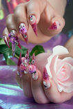 现有量美好的修指甲与玫瑰的 免版税库存照片