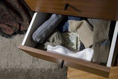 现金出票人隐藏的袜子 免版税库存照片