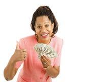现金拿着thumbsup妇女 免版税库存照片
