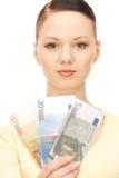 现金欧洲可爱的货币妇女 免版税库存图片