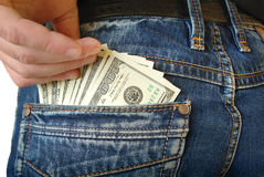 现金,金钱在蓝色牛仔裤的口袋 免版税库存图片
