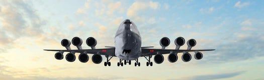现代乘客飞机飞行在日落全景 库存图片