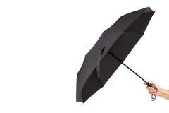现代黑伞在手中在白色背景 图库摄影