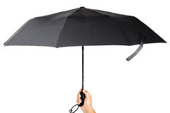 现代黑伞在handon白色背景中 库存照片