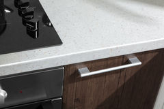 现代厨房把柄有电火炉烤箱细节的 免版税库存图片