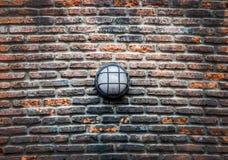 现代在老砖墙的街道电灯 库存照片