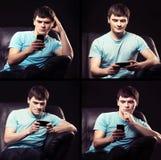 现代少年使上瘾对他的智能手机 图库摄影