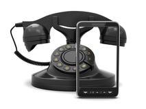 现代手机和减速火箭的转台式电话 免版税库存图片