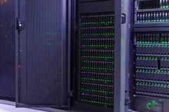 现代数据中心存贮黑暗的服务器室与蓝色光的 免版税库存照片