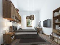 现代样式的大卧室与一个土气顶楼的元素 免版税库存照片