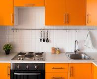现代橙色厨房 库存照片