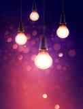 现代轻的电灯泡在bokeh背景中 库存图片
