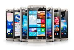 现代触摸屏幕智能手机的汇集 免版税库存照片