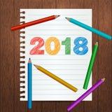 现代飞行物,与2018手拉的文本的海报模板 笔记本纸板料 五颜六色的色的铅笔,学校用品 库存照片