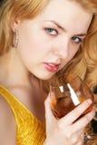 玻璃俏丽的妇女 免版税库存照片